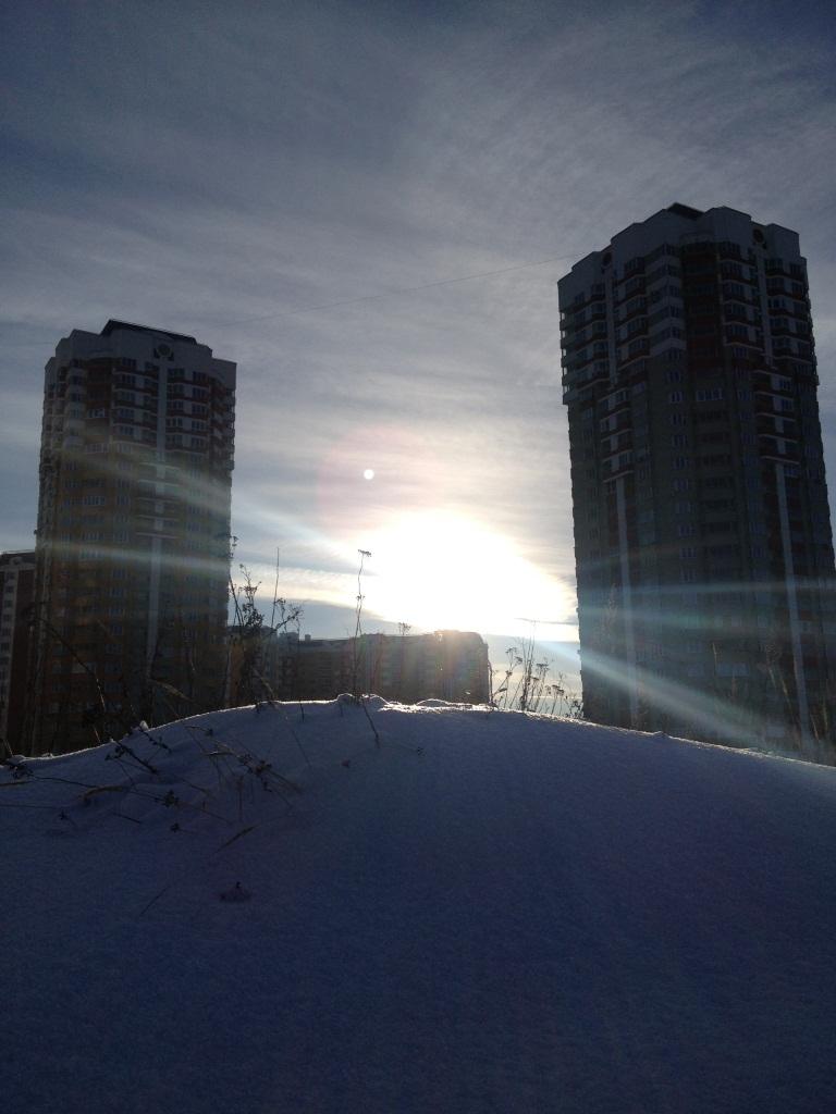 башни и солнце
